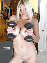 Chesty blonde MILF Slovanna pumps iron in these smoking hot pics