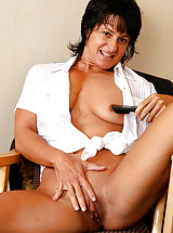 Horny MILF Cory can strip and play and still does her office chores